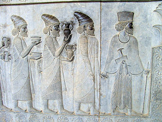"""Tribute - Objects in the """"Apadana"""" reliefs at Persepolis: armlets, bowls, and amphorae with griffin handles are given as tribute."""