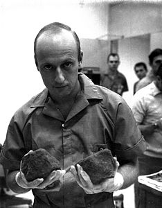 Apollo 12 Conrad with moon rocks.jpg
