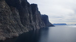 Appat Island - The southern shore of the island mostly consists of a series of precipitous walls