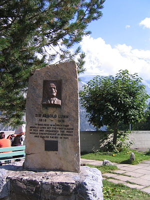 "Arnold Lunn - Memorial to Arnold Lunn in Mürren, Switzerland. The text reads, ""It was here in Mürren that Arnold Lunn set the first slalom in 1922 and organised the first world championship in downhill and slalom racing in 1931."""