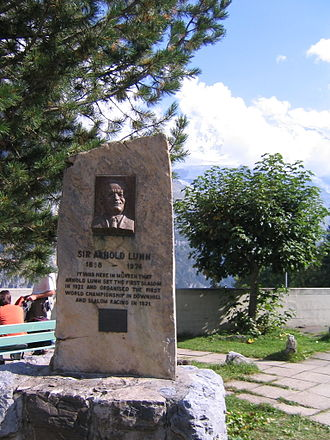 """Arnold Lunn - Memorial to Arnold Lunn in Mürren, Switzerland. The text reads, """"It was here in Mürren that Arnold Lunn set the first slalom in 1922 and organised the first world championship in downhill and slalom racing in 1931."""""""