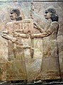 Assyrian attendants carrying the throne of Sargon II, part of a tributary scene from Khorsabad, Iraq. Iraq Museum.jpg
