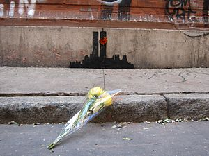 Better Out Than In - Flowers left in TriBeCa at Banksy's depiction of the former World Trade Center