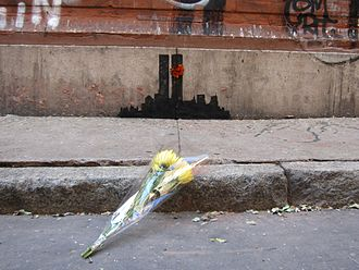 2013 in art - Flowers left at Banksy's depiction of the former World Trade Center in TriBeCa