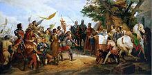 Tableau représentant de gauche à droite une armée qui s'incline devant un roi montrant sa couronne posée sur un coussin
