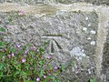 Benchmark on the tower of St Michael the Archangel, Kirkby Malham - geograph.org.uk - 970813.jpg
