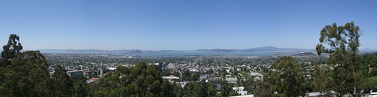 Looking west from the Berkeley Hills. Visible clockwise around the bay from the distant Golden Gate (upper center) are Marin County (Upper Right). Albany (Lower Right), Berkeley (Center and foreground), Emeryville (Lower Left), Oakland (Far Lower Left), South San Francisco (Far Upper Left) and San Francisco (Upper Left)