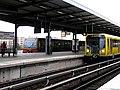 Berliner S- und U-Bahn am Bahnhof Wuhletal.jpg