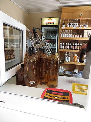 Growler (jug) - Plastic growlers at a beer shop in Biržai, Lithuania