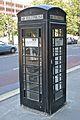 Black telephone box, London.jpg