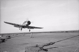 HMS Ark Royal (91) - A Blackburn Skua landing on Ark Royal. The Skuas were the mainstay of the Fleet Air Arm during the early Second World War. Also visible are the arrestor wires strung across the flight deck.