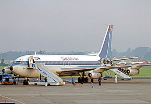 Trans European Airways - Early production Boeing 707-131 of TEA loading passengers via both access doors at Brussels Airport in 1977