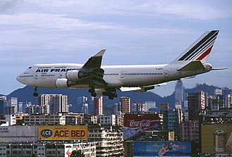 Kowloon Peninsula - An Air France Boeing 747 passing above Kowloon, landing at the old airport.