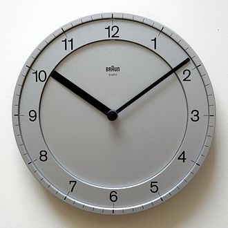 Clock face - A wall clock showing the time at 10:09