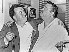 Gleason standing with Irish author Brendan Behan, arms around each other