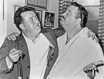 Prominent Irish writer Brendan Behan with Jackie Gleason in Gleason's dressing room after a performance of Take Me Along (1960)
