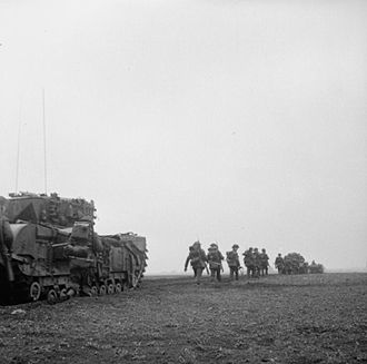 46th Infantry Brigade (United Kingdom) - Churchill tanks of the 4th (Armoured) Battalion, Coldstream Guards, 6th Guards Tank Brigade, and infantrymen of the 2nd Battalion, Glasgow Highlanders during the advance to the Siegfried Line, 8 February 1945.