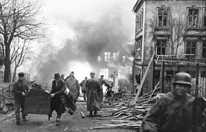 ST Voorbode - Burning and destroyed houses after the explosion