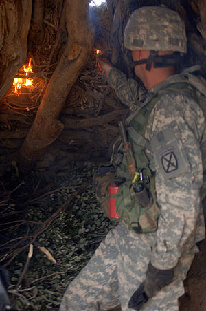 Al-Qaeda safe house - A Soldier from Charlie Company 2nd Battalion, 87th Infantry Regiment sets fire to a Taliban safehouse discovered during Operation Catamount Fury.