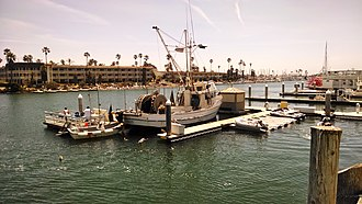 Channel Islands Harbor - Scene from commercial fishing boat unloading pier facing southeast with hotel in background