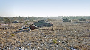 Military on Gotland - A 2005 photo of 4 IFVs (Stridsfordon 90) during an exercise at the Tofta skjutfält