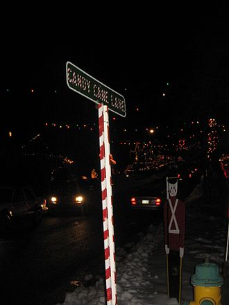 Candy Cane Lane, Duboistown - The Candy Cane Lane street sign, with decorations and lights behind