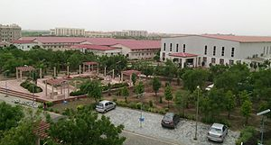 Central University of Rajasthan - Auditorium and temporary department buildings with permanent buildings in background