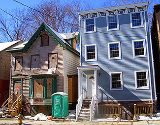 These homes on Chambers Street show the two faces of contemporary Newburgh: both historic, one newly renovated, the other exemplifying urban blight.
