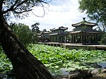 Several Chinese style pavilions near a lotus pond.