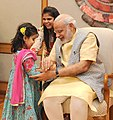 Children tying 'Rakhi' on the Prime Minister, Shri Narendra Modi's wrist, on the occasion of 'Raksha Bandhan', in New Delhi on August 29, 2015 (8).jpg