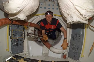 Christer Fuglesang - Fuglesang at work, floating through a hatch on Space Shuttle Discovery during flight on day two of Mission STS-116.