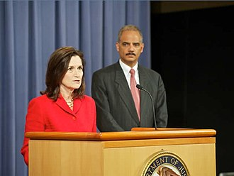 Christine A. Varney - Varney (left) speaks on credit card fraud as Assistant Attorney General for the Antitrust Division in 2010, with Attorney General Eric Holder at right