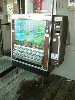 Cigarette machine vending machine that takes cash in payment for packs of cigarettes