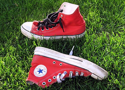 A red pair of Converse Chuck Taylor All-Stars
