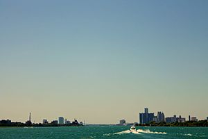 Detroit–Windsor - Detroit skyline to the right and Windsor to the left of the Detroit River