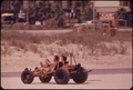 DUNE BUGGY ON STEWART BEACH ON THE EASTERN TIP OF GALVESTON ISLAND - NARA - 550935.tif