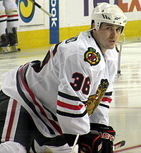 Hockey player warms up prior to a game as he intensely looks at the camera