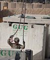 Defense.gov News Photo 110915-A-FZ921-131 - U.S. Army Staff Sgt. Rick Cavazos gets ready to hook up another Jersey barrier to a crane in Spin Boldak Kandahar province Afghanistan on Sept.jpg