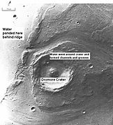 Large floods of water likely eroded the channels around the crater. (Lunae Palus quadrangle)