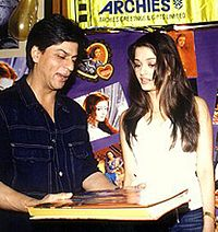 Shah Rukh Khan views a book with Aishwarya Rai in 2002