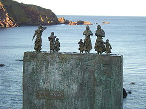 Eyemouth disaster - The bronze memorial at St Abbs - figures of women and children look out to sea