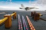 F-A-18F Super Hornet lands on USS John C. Stennis' flight deck during flight operations. (31229257632).jpg