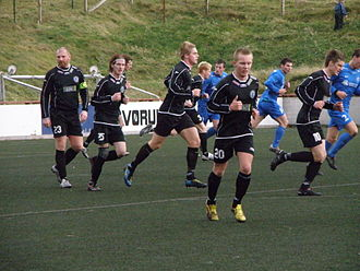 Víkingur Gøta - Víkingur Gøta in a match in Vodafonedeildin against FC Suðuroy in October 2010. They used their away colours (black).