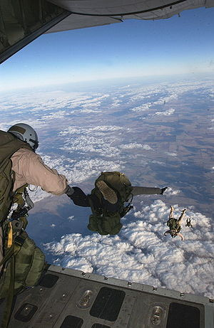 1st Force Reconnaissance Company - Force Reconnaissance Marines conduct High Altitude Low Opening (HALO) parachute operations from the back of a C-130.