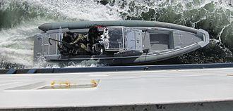 Forsvarets Spesialkommando - FSK during training in the Oslofjord, entering a ferry by telescopic ladder