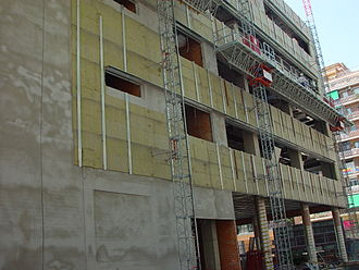 Furring - Vertical, metal furring is applied to the wall to create a channel and receive the siding material