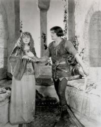 Fairbanks Robin Hood giving Marian a dagger.jpg