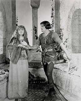 Fairbanks Robin Hood giving Marian a dagger.jpg