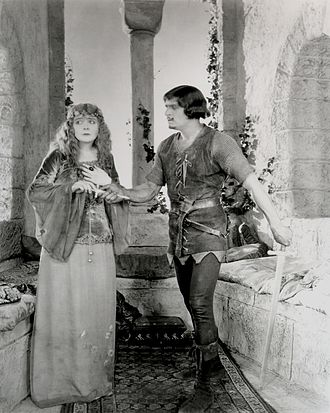Maid Marian - Douglas Fairbanks as Robin Hood giving Enid Bennett as Maid Marian a dagger