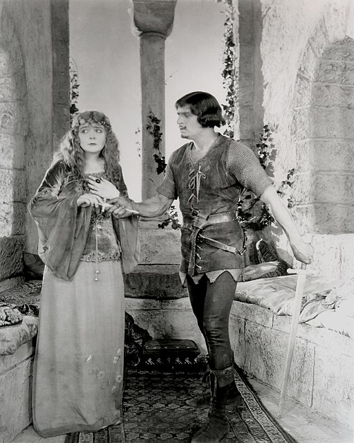 Fairbanks Robin Hood giving Marian a dagger